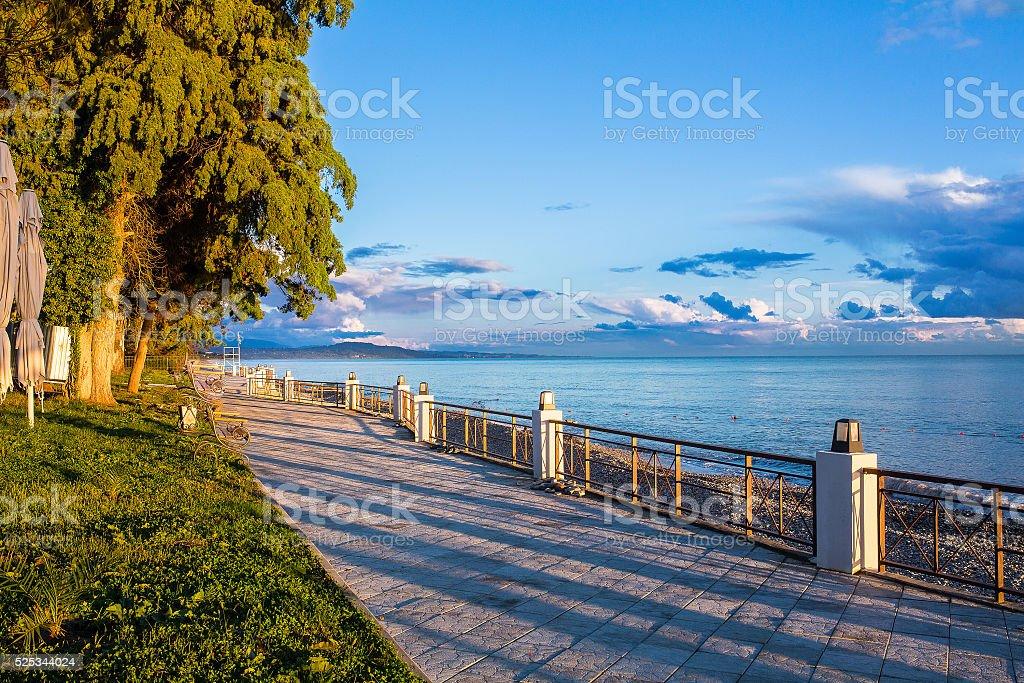 Black Sea embankment at sunset New Athos Abkhazia stock photo