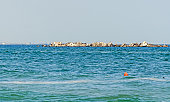 Black Sea, seafront and seaside with blue water and rocks