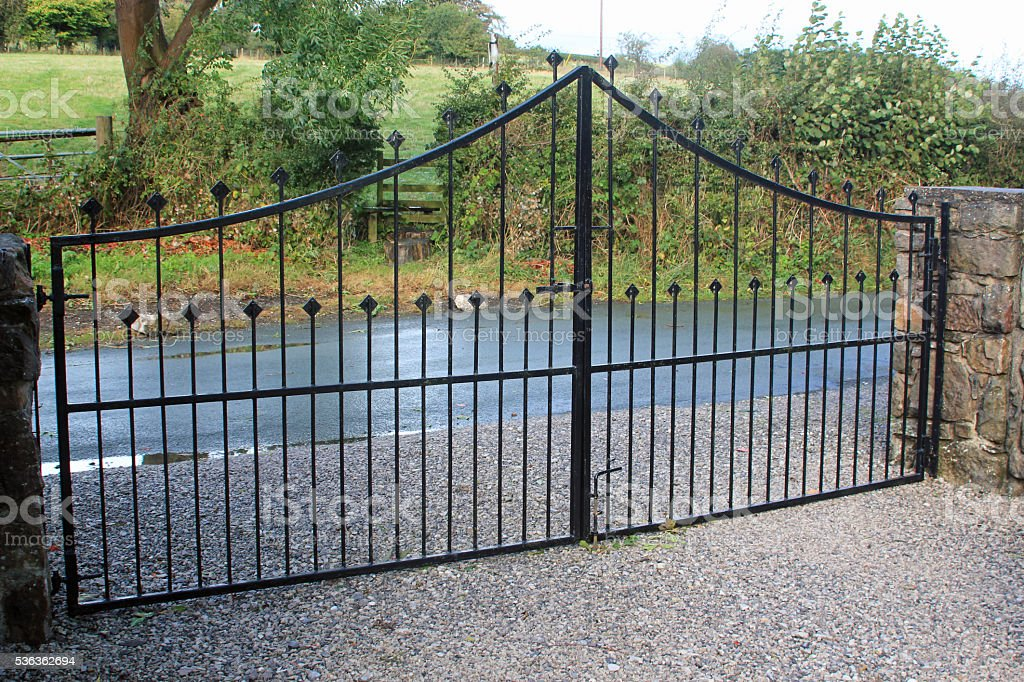 Black security gates protecting a residential property stock photo