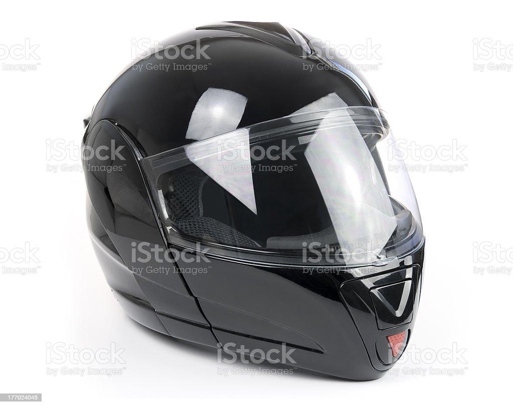 Black, shiny motorcycle helmet stock photo