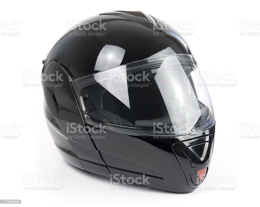 Black, shiny motorcycle helmet stock photo