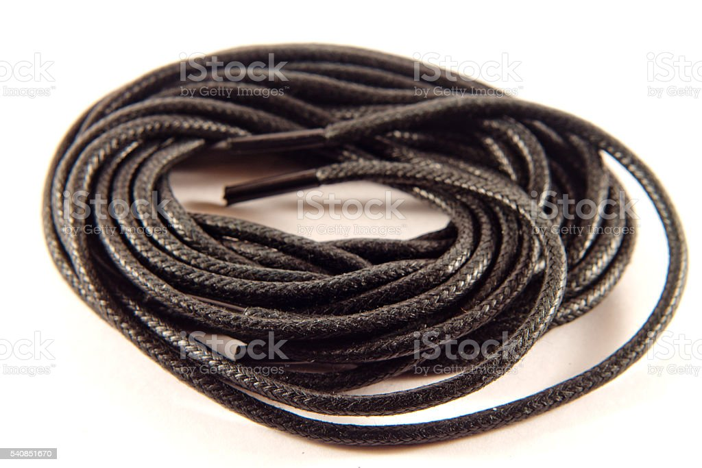 Black shoelaces / shoe on a white background stock photo