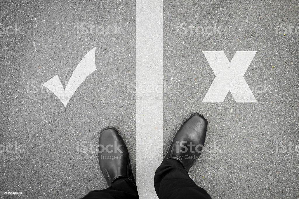 Black shoes standing between right and wrong stock photo