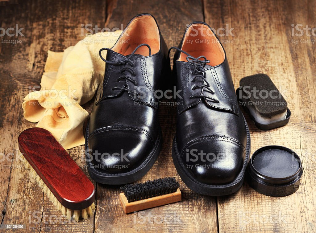 black  shoes with care accessories stock photo