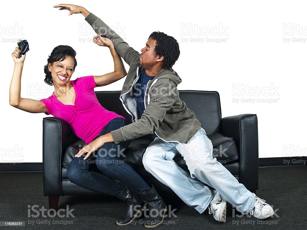 Black Siblings Fighting Over a Video Game Controller royalty-free stock photo