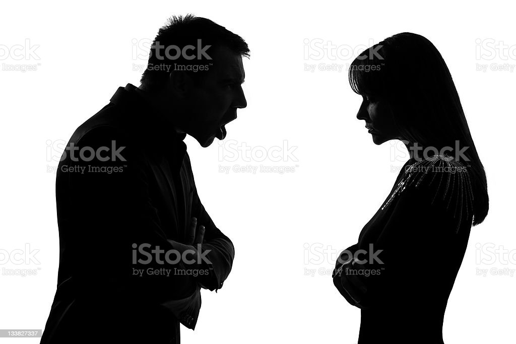 Black silhouettes of a man and woman couple in an argument royalty-free stock photo