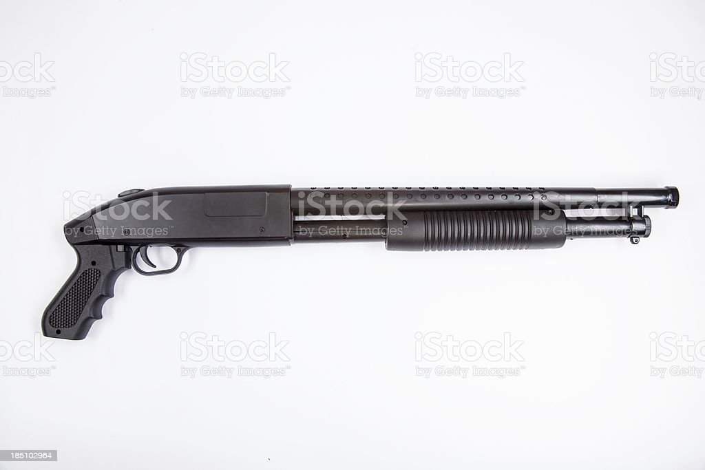 Black Single Barrel Hand Pump Shotgun Displayed on White Background stock photo