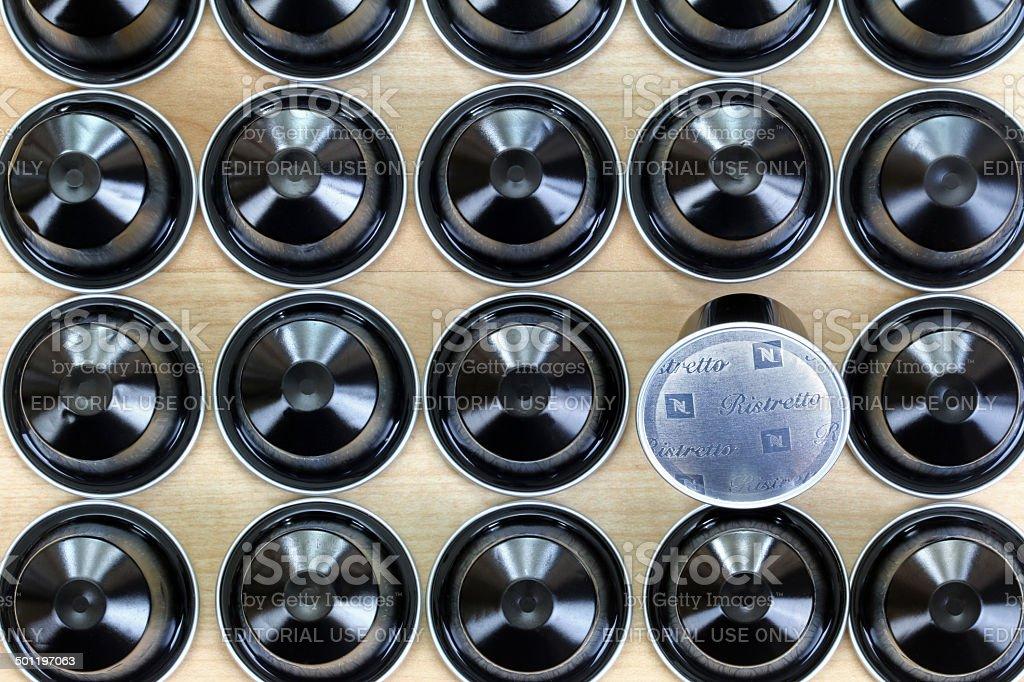 Black single-serve Ristretto Nespresso capsules stock photo