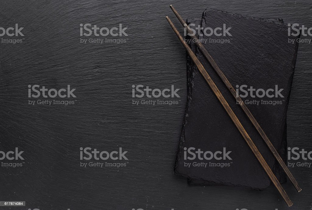 Black slate board and chopsticks stock photo