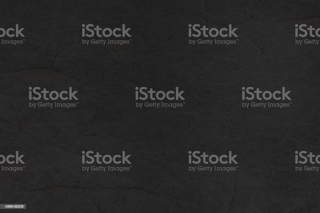 black slate stone tile background - granite texture closeup stock photo
