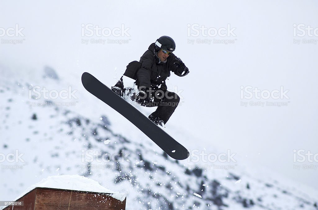 Black snowboarder fly stock photo
