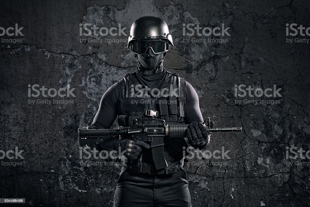 Black soldier with rifle stock photo
