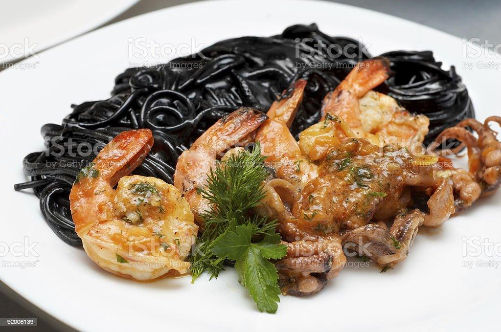 black spaghetti with shrimps royalty-free stock photo