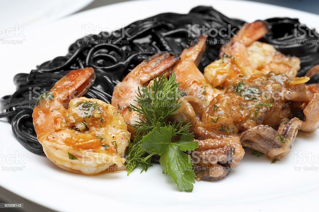 black spaghetti with shrimps royalty-free stock photo