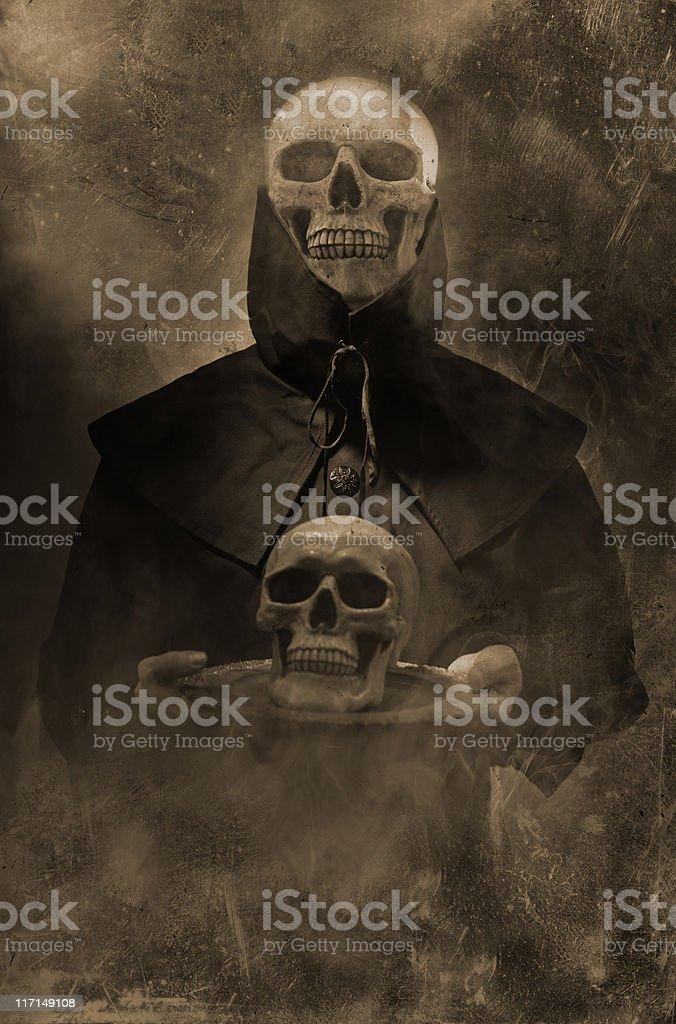 Black Spirit of Death holding skull on platter smoke occult stock photo