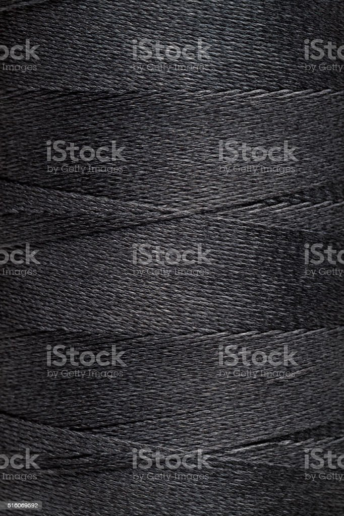 Black spool of thread stock photo