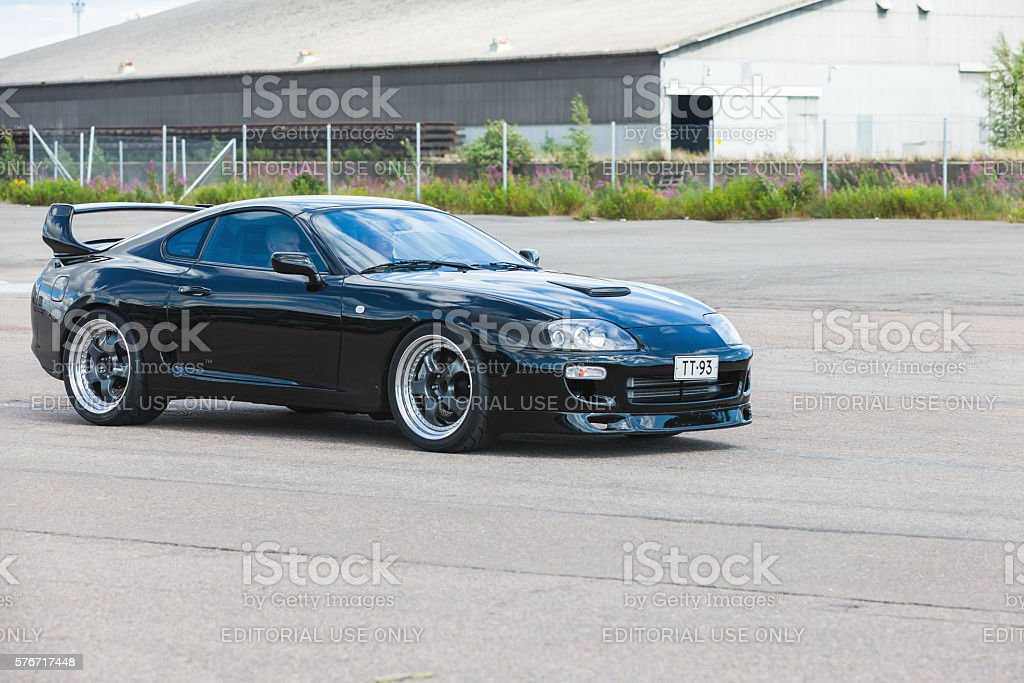 Black sporty Toyota Supra A80 stock photo