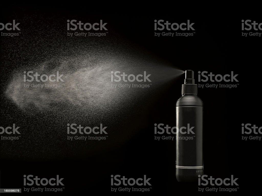 black spraycan spraying stock photo