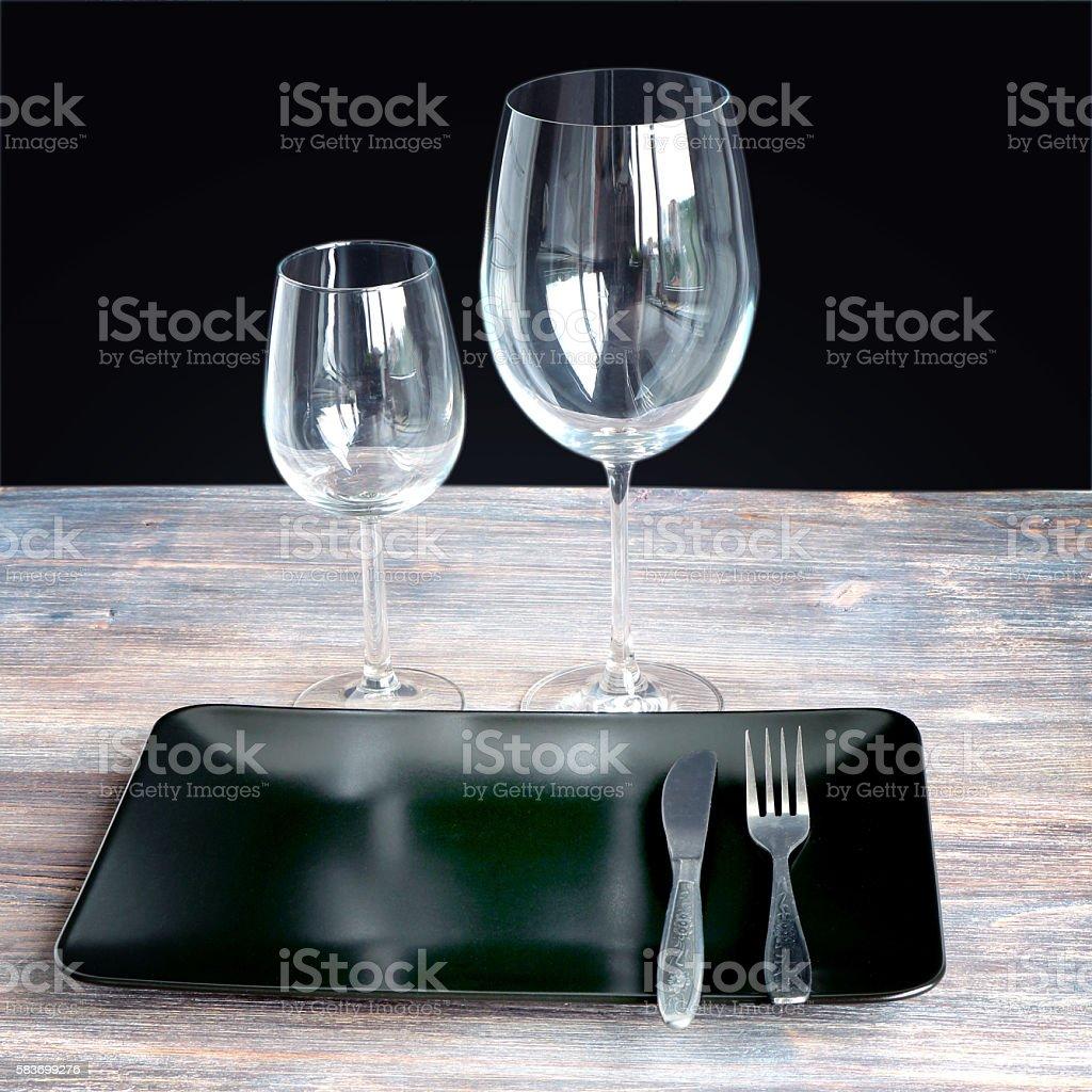 black square simple clean design black plate and wine glasses black square simple clean design black plate and wine glasses royalty stock