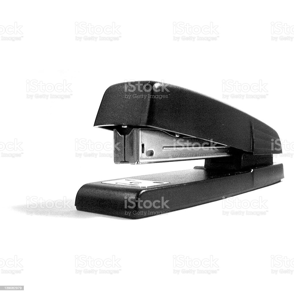 A black stainless steel stapler on a white background royalty-free stock photo