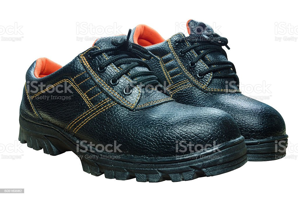 Black steel toe safety boots on white background. stock photo