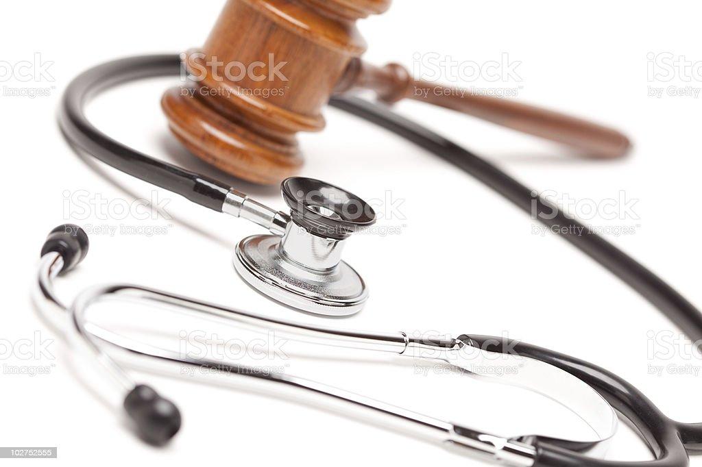Black Stethoscope and Gavel on White stock photo