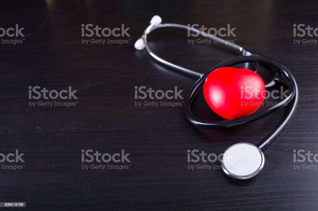 Black stethoscope heart stock photo