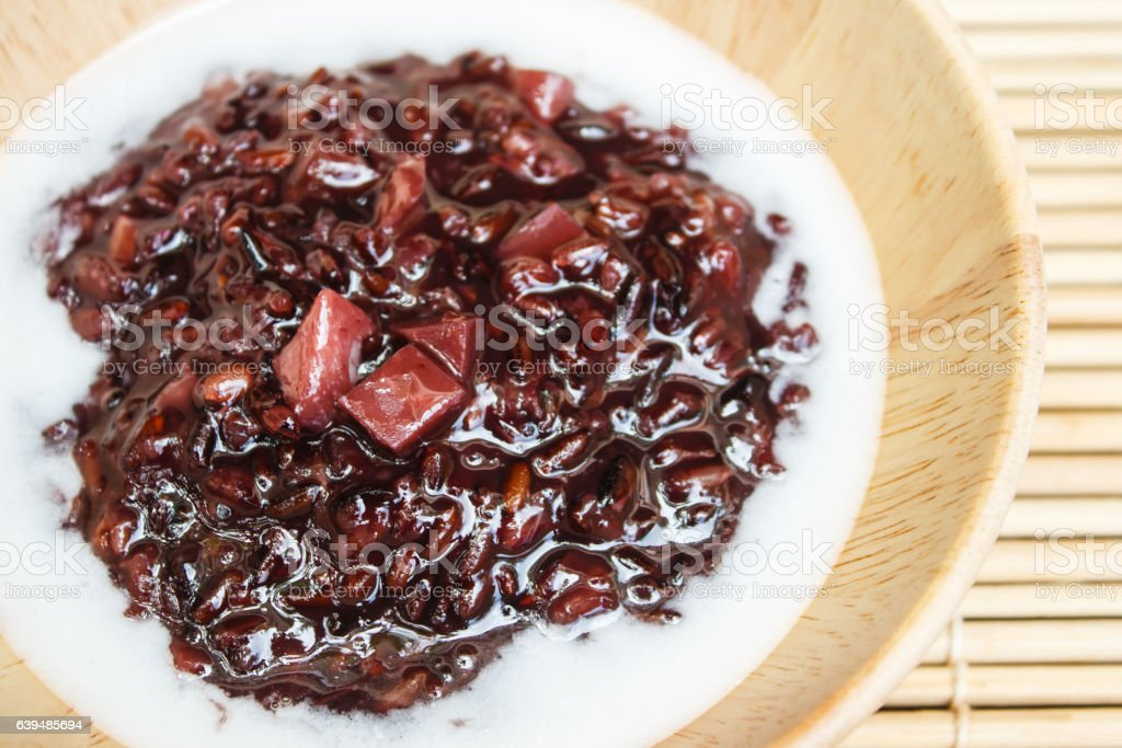 Black sticky rice pudding with taro, Thai dessert. stock photo