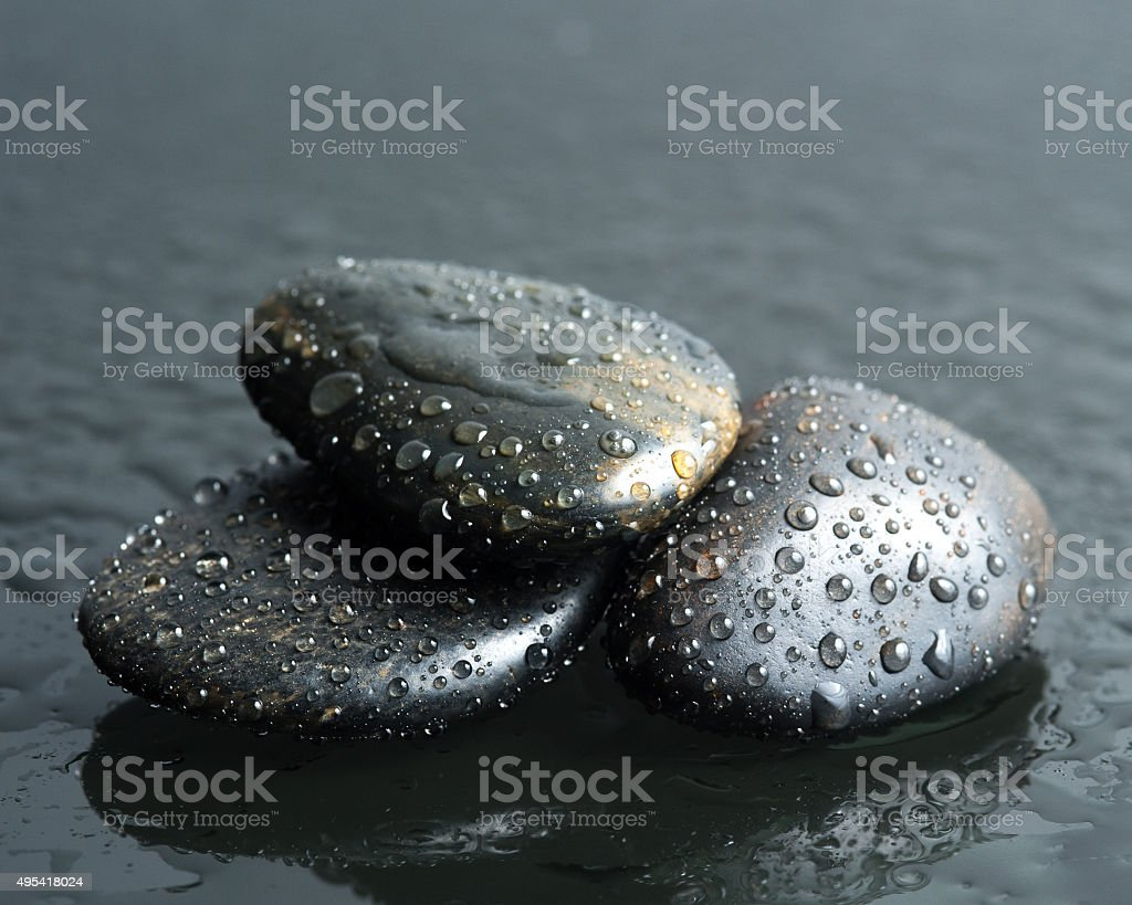 Black stone and water drop stock photo