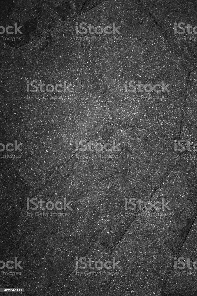 black stone wall surface stock photo
