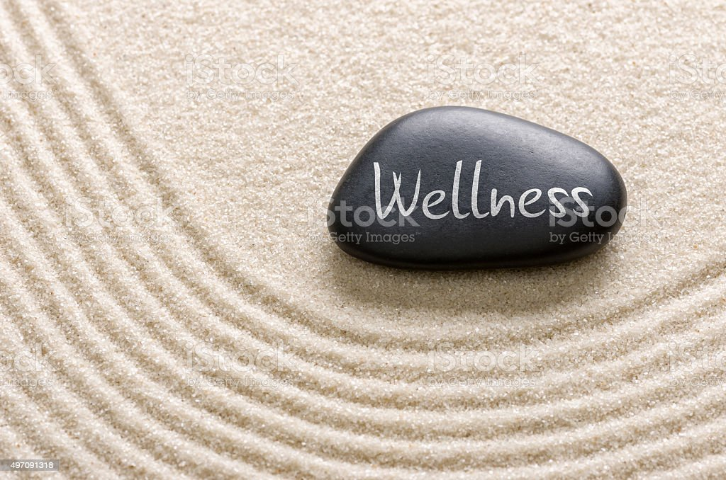 Black stone with the inscription Wellness stock photo