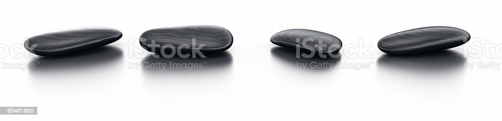 Black stones on reflective floor royalty-free stock photo