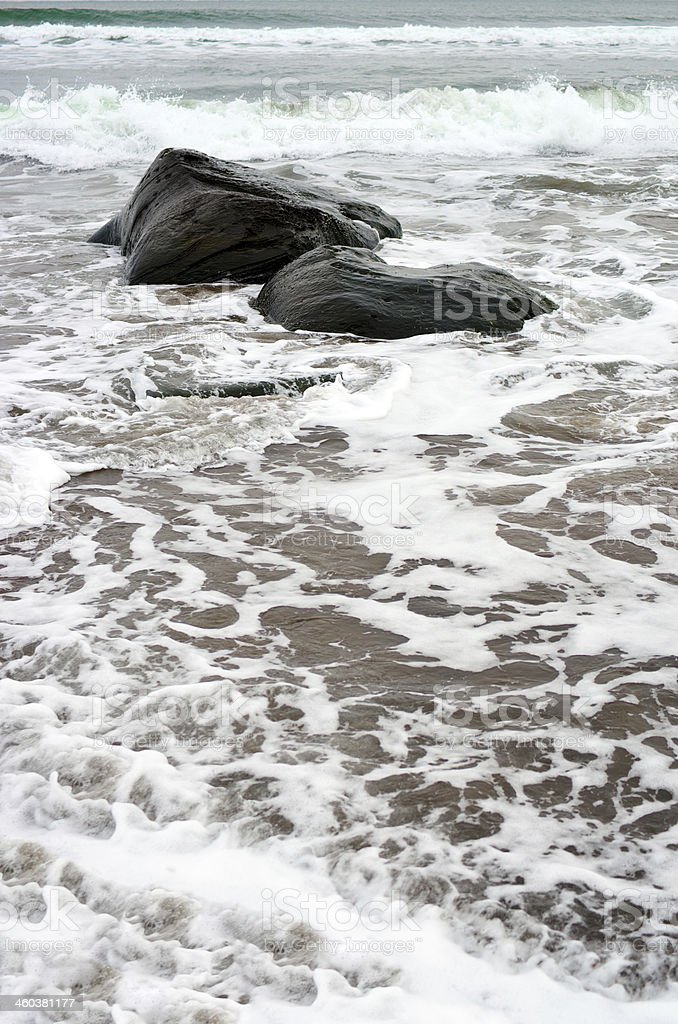Black stones on the beach stock photo
