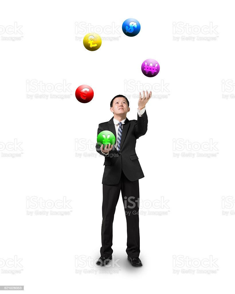 black suit businessman juggling currency symbol balls stock photo