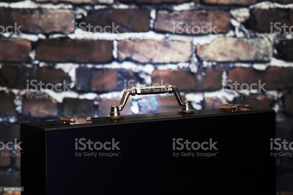 Black suitcase with shiny handle stock photo