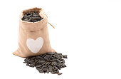 Black sunflower seeds in a bag
