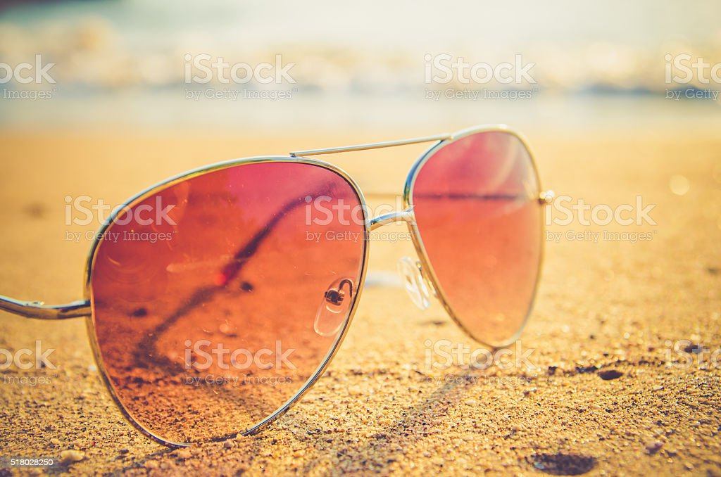 black sunglasses and sea background stock photo