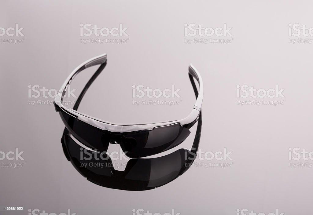 Black sunglasses on grey stock photo