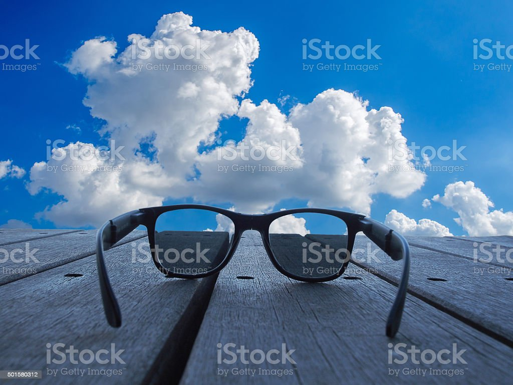 Black sunglasses Placed on a wooden board. stock photo