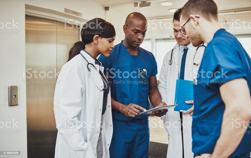Black surgeon giving instruction to medical team stock photo