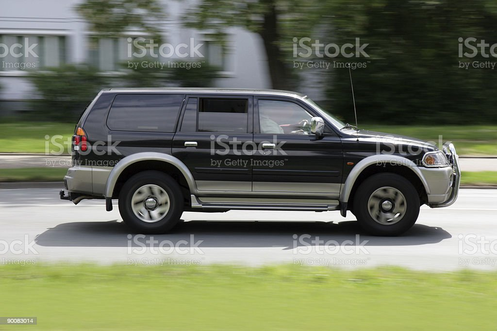black SUV speeding royalty-free stock photo