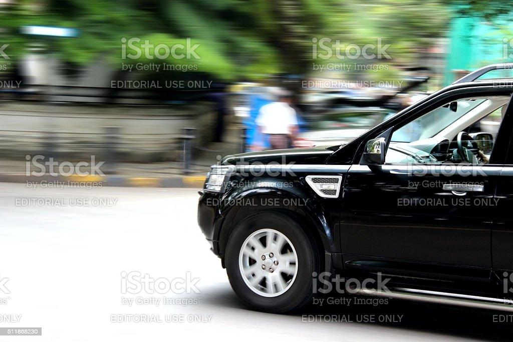 Black SUV taking Turn stock photo