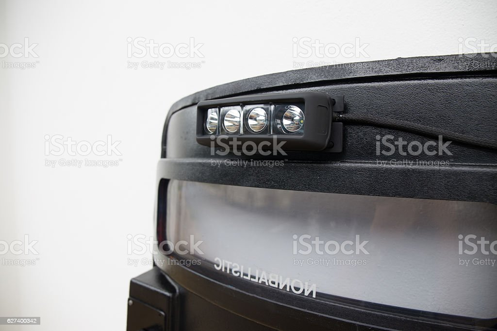 black tactical ballistic shield with flash light stock photo