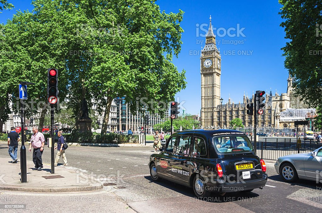 Black taxi cab in front of Big Ben. London, UK stock photo