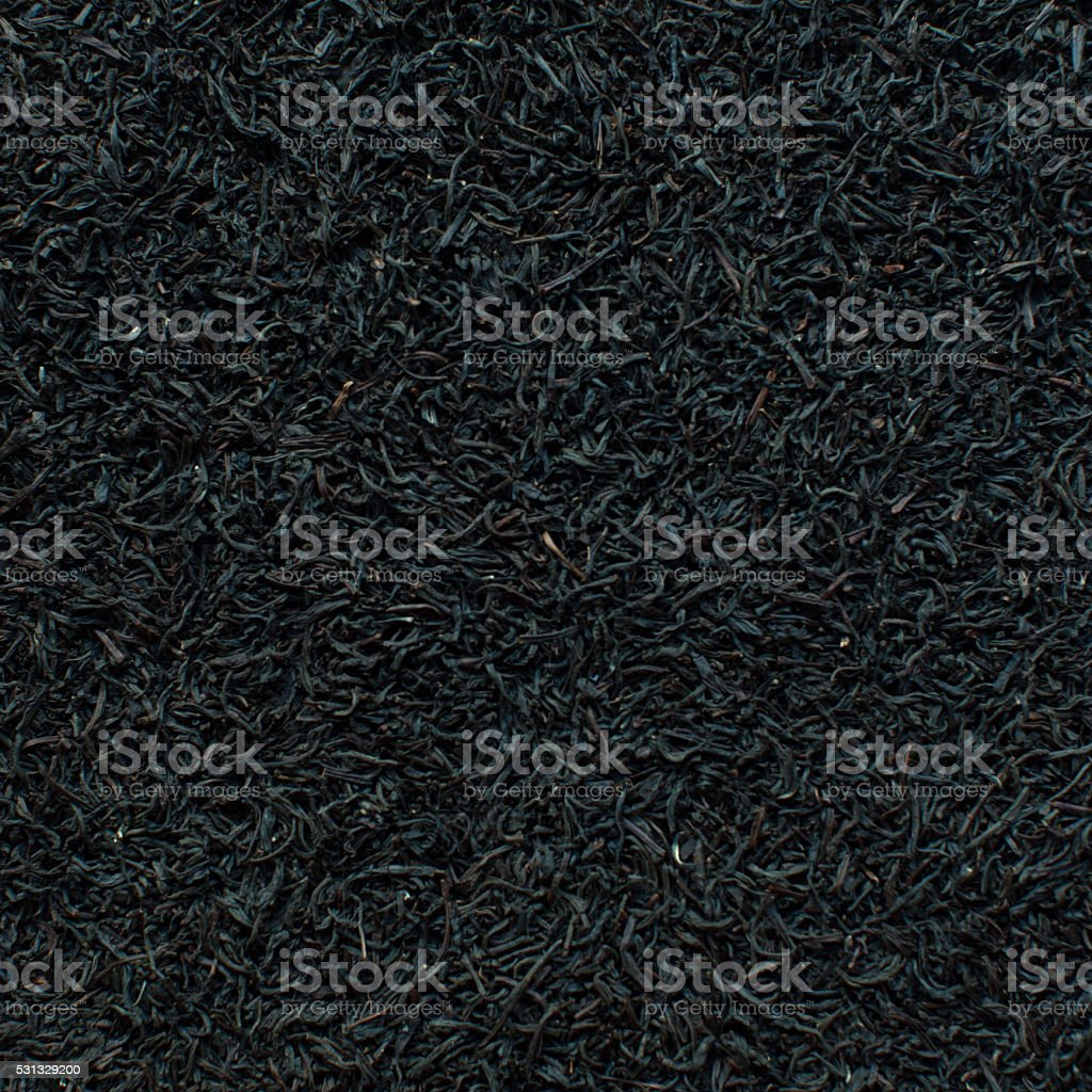 Black tea dried leaves background stock photo