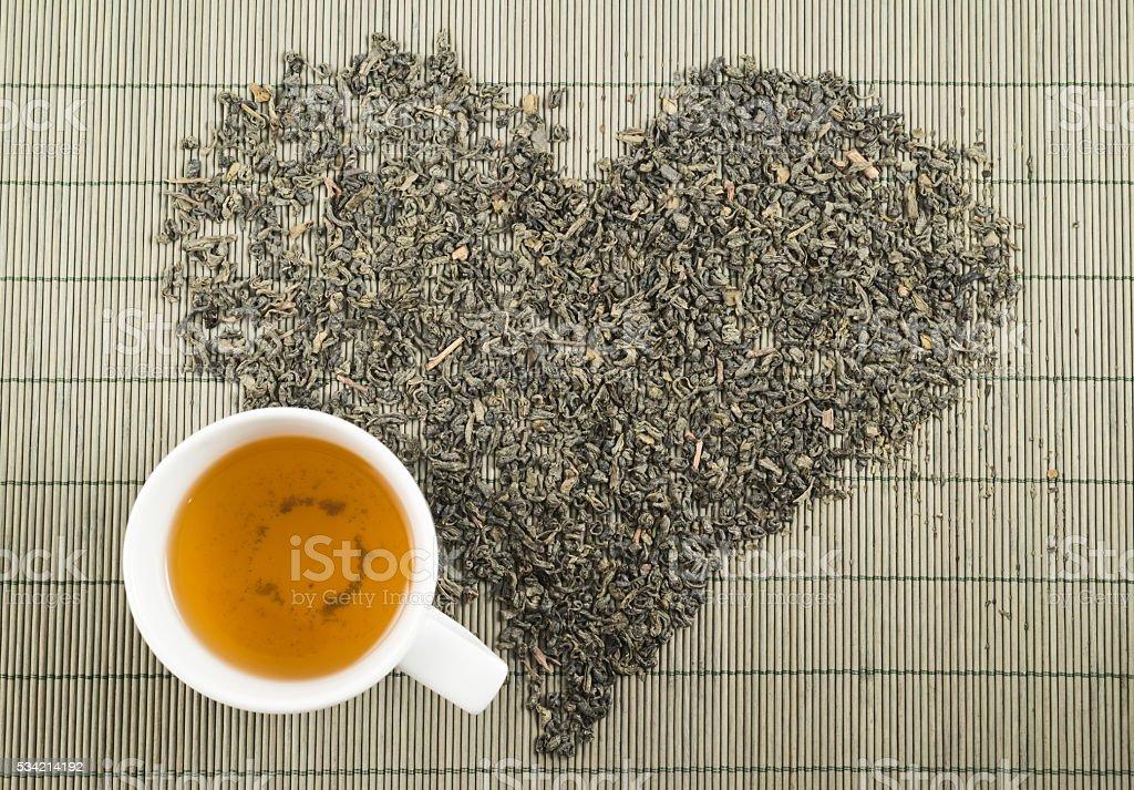 Black tea heart shape topview stock photo