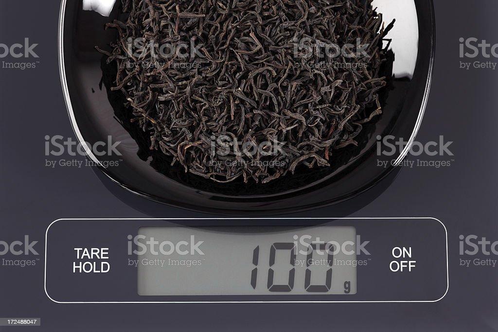Black tea leaves on kitchen scale royalty-free stock photo