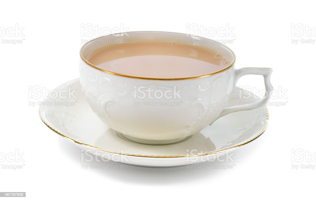 Black tea with milk in a porcelain cup. stock photo