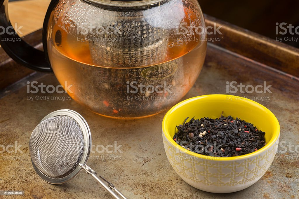 Black tea with pot stock photo