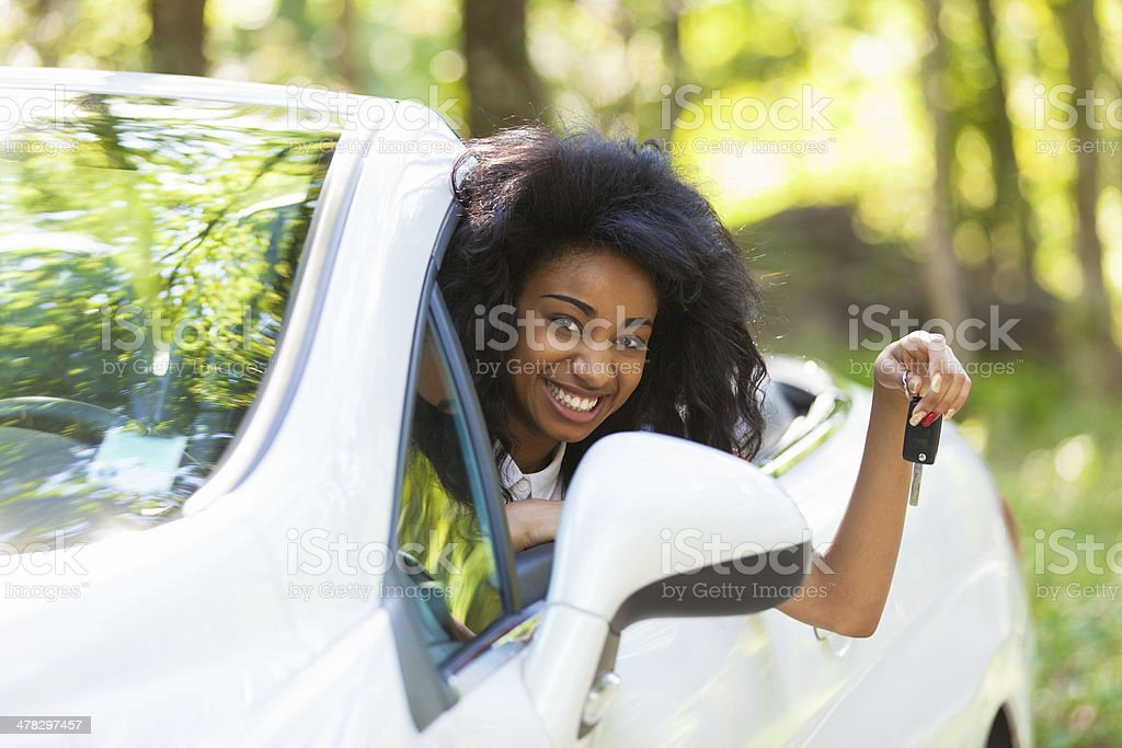 Black teenage driver holding car keys stock photo